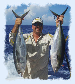 Key West offshore fishing guide holding 2 yellow fin tuna.
